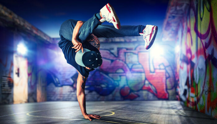 Man breakdancing is a representation of flexible order management